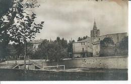 13403 - LUNEL - QUAI VOLTAIRE ET L'EGLISE  ( Gr. CAFE DU COMMERCE ) - Lunel