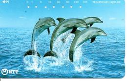 Dauphin Dauphins Dolphine Poisson Télécarte Phonecard Japon (D 1102) - Dolphins