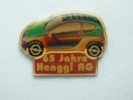 Pin's OPEL CORSA - 65 JAHRE HENGGI AG - Opel