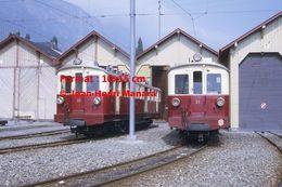 Reproduction D'une Photographie D'une Vue De Deux Trains MC Martigny-Chatelard à Crémaillère En Dépôt En Suisse En 1968 - Riproduzioni