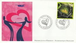 ENVELOPPE 1er JOUR . DU 18.01.2002 . YANN ARTHUS BERTRAND . CACHET PARIS - 2000-2009