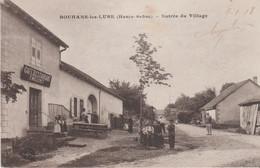 70 BOUHANS-LES-LURE ENTREE DU VILLAGE AVEC VUE SUR LE CAFE RESTAURANT MILLERET - Andere Gemeenten