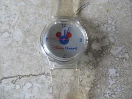 Montre Publicitaire DISNEY CHANEL Bracelet Plastique Transparent En état De Fonctionnement Si Pile Operationelle. - Orologi Pubblicitari