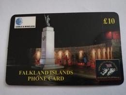 FALKLAND ISLANDS  10 POUNDS  LIBERATION MONUMENT AT NIGHT   PREPAID   **4416** - Falklandeilanden