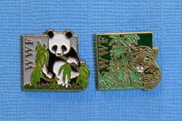 2 PIN'S // ** WWF / FONDS MONDIAL POUR LA NATURE / LE PANDA GÉANT ET LE LÉOPARD OU PANTHÈRE ** - Animali