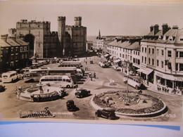 Castle Square, Caernarvon, Caernarvonshire ( Coaches, Fountain & Roundabout) RP - Caernarvonshire