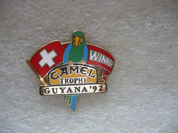 Pin's Camel Trophy Guyana 92. La Suisse Championne Du Trophy. Perroquet, Perruche - Rallye