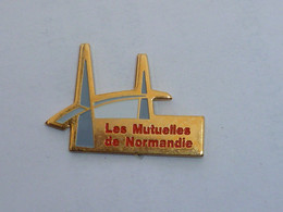 Pin's PONT DE NORMANDIE , MUTUELLES DE NORMANDIE - Banche