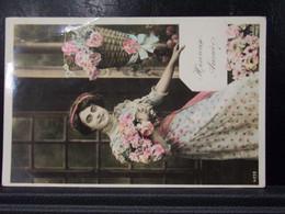 259 . HEURESE ANNEE . FEMME AVEC DES FLEURS . 1911 - New Year