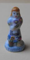 Fève 1993 L'artisanat * La Fleuriste (T 1614) Socle Bleu - Santons