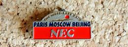 Pin's INFORMATIQUE TECHNOLOGIE - Imprimante NEC Rallye Paris Moscou Pékin - Peint Cloisonné - Fabricant Inconnu - Computers