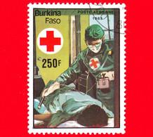 BURKINA FASO - Nuovo Oblit.- 1985 - 75 Anni Della Croce Rossa - Infermiere E Paziente - 250 P. Aerea - Burkina Faso (1984-...)