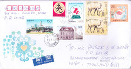CHINA : PRE STAMPED OFFICIAL POSTAL ENVELOPE : YEAR 2000 : SENT TO THAILAND : USED WITH 6v ADDITIONAL POSTAGE STAMPS - Brieven En Documenten