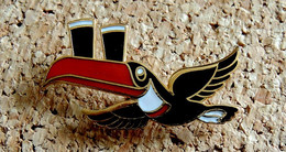 Pin's ANIMAUX OISEAUX - TOUCAN Bière GUINNESS Grand Modèle 43mm - EMAIL - Fabricant Inconnu - Animaux