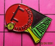 912c Pin's Pins / Beau Et Rare / THEME : SPORTS / TENNIS DE TABLE HANDISPORT LAUDUN PING-PONG - Tennis Tavolo