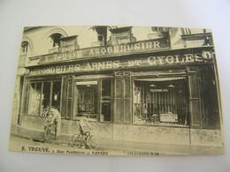 CPA - Nantes (44) - Arquebusier E.Trouvé - Automobiles , Armes & Cycles - 1910 - SUP - (EV 68) - Nantes