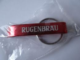Werbeschlüsselanhänger: Kapselöffner, Rugenbräu, Kanton Bern, Schweiz. - Bottle Openers