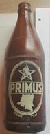 Vieille Bouteille Peinte  (sérigraphie ) Primus Bralima Kinshasa République Du Congo 72 Cl - Beer