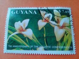 """GUYANE - GUYANA - Timbre 1991 : 700 Ans De La Confédération Helvétique - Fleurs Série """"Orchidées"""" - Guyana (1966-...)"""