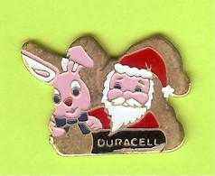 Pin's Duracell Lapin Et Père Noël (Pile) - 4X27 - Merken
