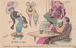 """VE 13- """" LA MODE EN 1910 """" - CARTE HUMORISIQUE - ILLUSTRATEUR SAGER - COUPLE ATTABLE SE MOQUANT D' UNE COQUETTE ENTRAVEE - Sager, Xavier"""