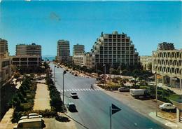 CPSM LA GRANDE MOTTE - L'avenue De L'Europe    L687 - Altri Comuni