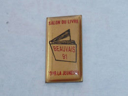 Pin's SALON DU LIVRE POUR LA JEUNESSE DE BEAUVAIS, 1991 - Mass Media