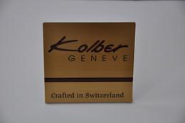 Plaque En Métal Revendeur 'Kolber Genève' - Plaques émaillées (après 1960)