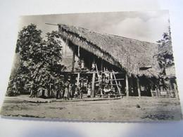 CPA - Grand Format - Océanie - Nouvelle Guinée Papouasie - Maisons En Forme Gueule De Crocodile   1930 -  SUP  (FE 14) - Papua Nuova Guinea