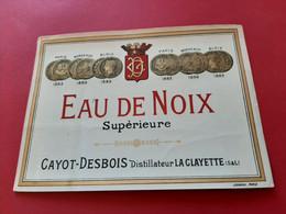 ETIQUETTE . JOUNEAU - PARIS / EAU DE NOIX SUPERIEURE / CAYOT - DESBOIS DISTILLATEUR LA CLAYETTE ( S & L )  /  DOS SCANNE - Non Classés
