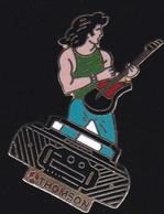 71643- Pin's- Thomson.Rock.guitare.signé A.B.42221920 - Marche