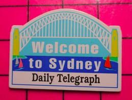 312c Pin's Pins / Beau Et Rare / THEME : VILLES / PIN'S AUSTRALIEN JEUX OLYMPIQUES SIDNEY JOURNAL DAILY TELEGRAPH - Villes