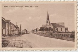 CPA  Hoves (Belgique)  L'entrée Du Village, Les Rails Du Tramway Et L'église - Other