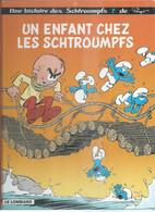 """LES SCHTROUMPFS """" UN ENFANT CHEZ LES SCHTROUMPFS """" - PEYO - E.O.  JANVIER 2007  LOMBARD - Schtroumpfs, Les"""