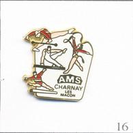 Pin's Gymnastique / AMS (Association Musicale Et Sportive) à Charnay Lès Mâcon (71). Est. Dimo. Zamac Fin. T818-16 - Ginnastica