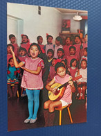 Mongolia. Ulan Bator. Mongolian Kindergarten - Girl Singing - Folk String Instrument - Mongolia