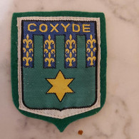 Coxyde  7,5CM/6CM - Blazoenen (textiel)