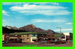 JASPER, ALBERTA - CONNAUGHT AVENUE  WITH PYRAMID MOUNTAIN IN BACKGROUND - PUB. BY J. H. BELL - - Jasper