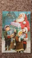 CPSM JOYEUX NOEL PERE NOEL ET ENFANTS LES BRAS CHARGES DE CADEAUX  SANTA CLAUS - Santa Claus
