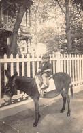 ANE  -  Carte Photo Ancienne D'un Enfant Sur Un Ane ( Postée De VICHY En 1924 ) - Donkeys